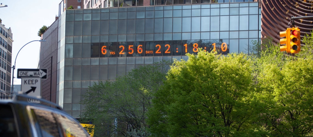 A large Climate Clock on the side of an office building counting down the days remaining to hit zero emissions.